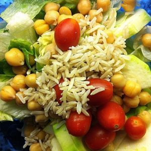 Photo of rice with lettuce, chick peas, cherry tomatoes, zucchini