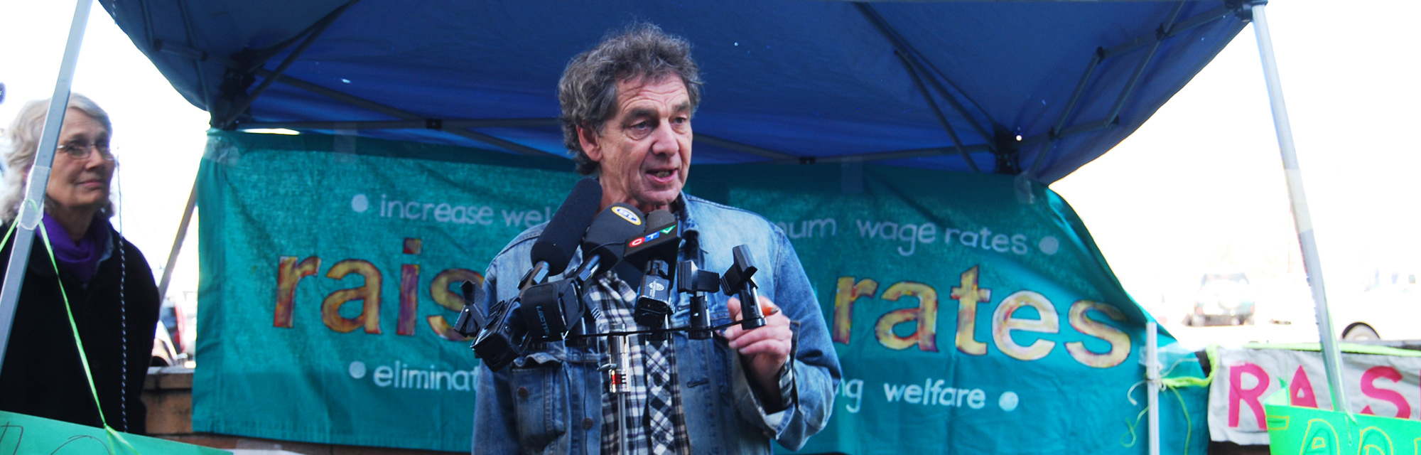 Photo of Bill Hopwood of Raise the Rates launching the 2013 Welfare Food Challenge