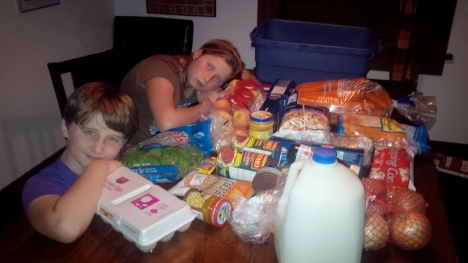Photo of the Gent Family and groceries for the 2014 Welfare Food Challenge