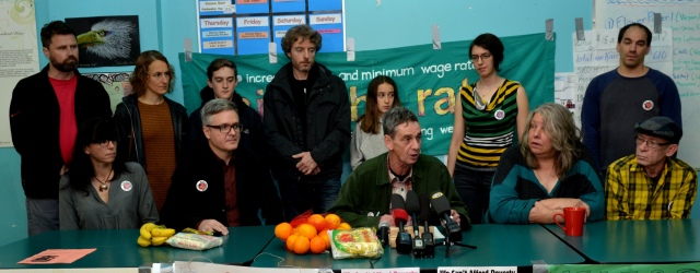 Photo of some of the 2016 Welfare Food Challenge Participants speaking to the Press at the launch of the Challenge at the Downtown Eastside Neighbourhood House