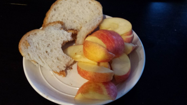 Photo of a plate with bread and apple slices on it.