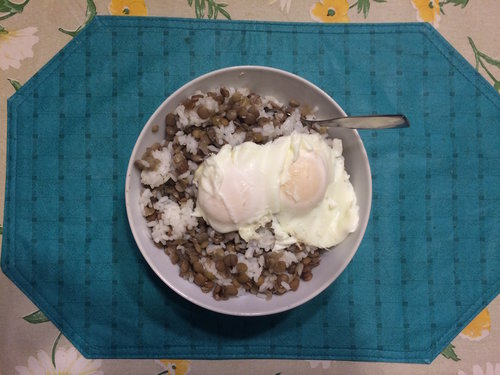 Photo of bowl of rice and lentiles wiht 2 poached eggs on top
