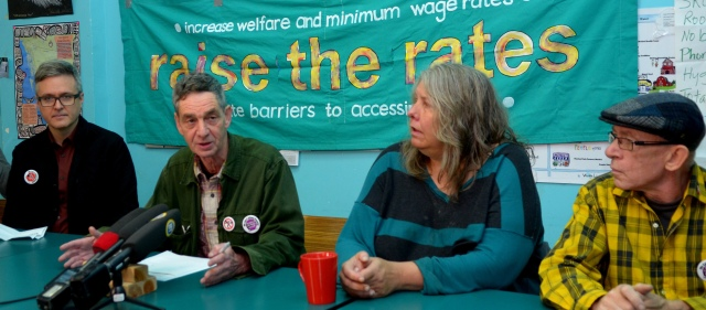 Photo of Bill Hopwood speaking to the Press at the launch of the Welfare Food Challenge at the Downtown Eastside Neighbourhood House on Sun, Oct 16, 2016